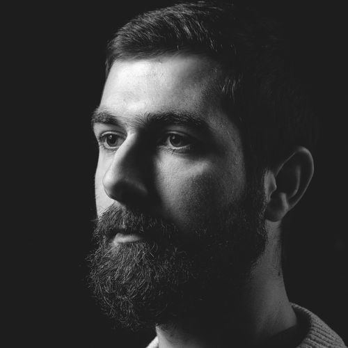 Black Label Beard Black Background Close-up Headshot Human Face Indoors  Lifestyles One Person Portrait Real People Serious Studio Shot The Portraitist - 2017 EyeEm Awards Young Adult Young Men The Portraitist - 2018 EyeEm Awards