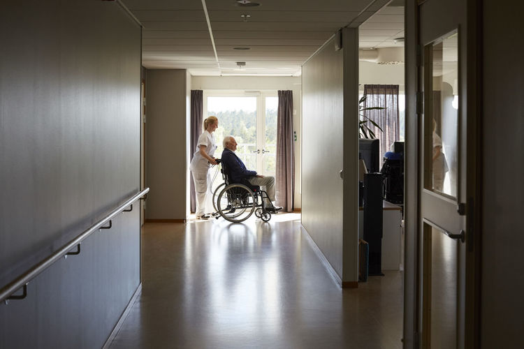 Man sitting in corridor of building