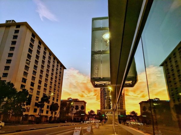 Sunset over downtown Orlando Florida Reflection Glass Windows Downtown Sunset Sunlight Nature Blue Sky Architecture Built Structure City Sky Building Exterior Sunset Skyscraper Outdoors Day Modern No People