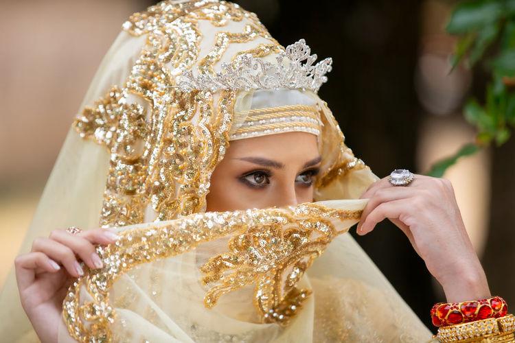 Woman in hijab looking away