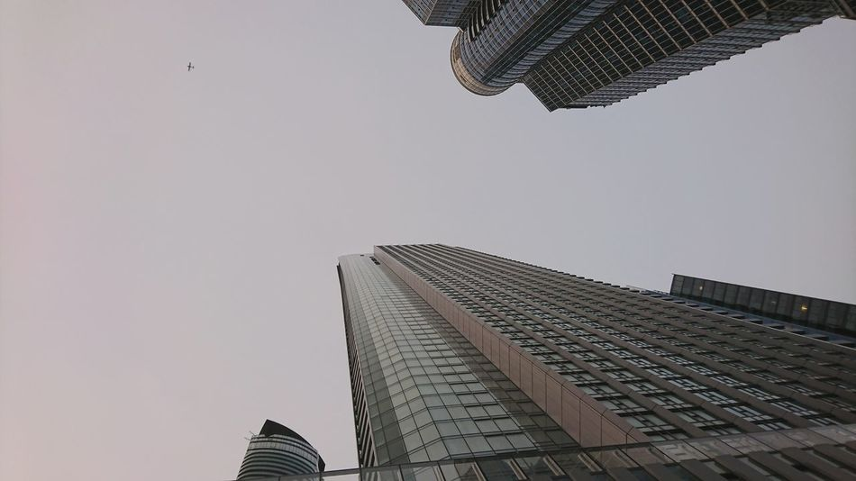 Long way up Sony XZ Travel EyeEm Selects Looking Up City Skyscraper Modern Business Finance And Industry Sky Architecture Building Exterior Built Structure Tall - High Office Building Building Story Skyline City Location Urban Skyline Cityscape Tower Infrastructure