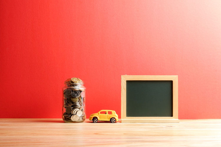 Objects on table against red wall
