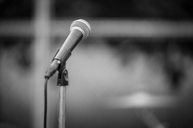 Microphone and Tripod on background blurred Blurred Absence Arts Culture And Entertainment Close-up Communication Focus On Foreground Input Device Microphone Microphone Stand Music No People Outdoors Performance Performing Arts Event Selective Focus Speech Stage Stage - Performance Space Talking Technology Tripod