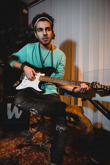 Portrait Photography Portraits Portrait EyeEm Selects Music Musical Instrument Guitar Young Adult Playing One Person String Instrument Casual Clothing Musician Indoors  Performance Lifestyles Electric Guitar Leisure Activity