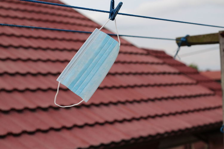 Low angle view of clothespins hanging on roof