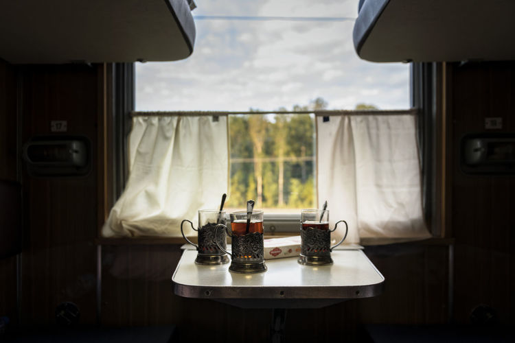 Nature Food Still Life Drink Glass Container Travel Table Window Day Restaurant Food And Drink Business Plate Refreshment Absence Transparent Tray No People Wellbeing Focus On Foreground Glass - Material Rail Transportation Tea Seat
