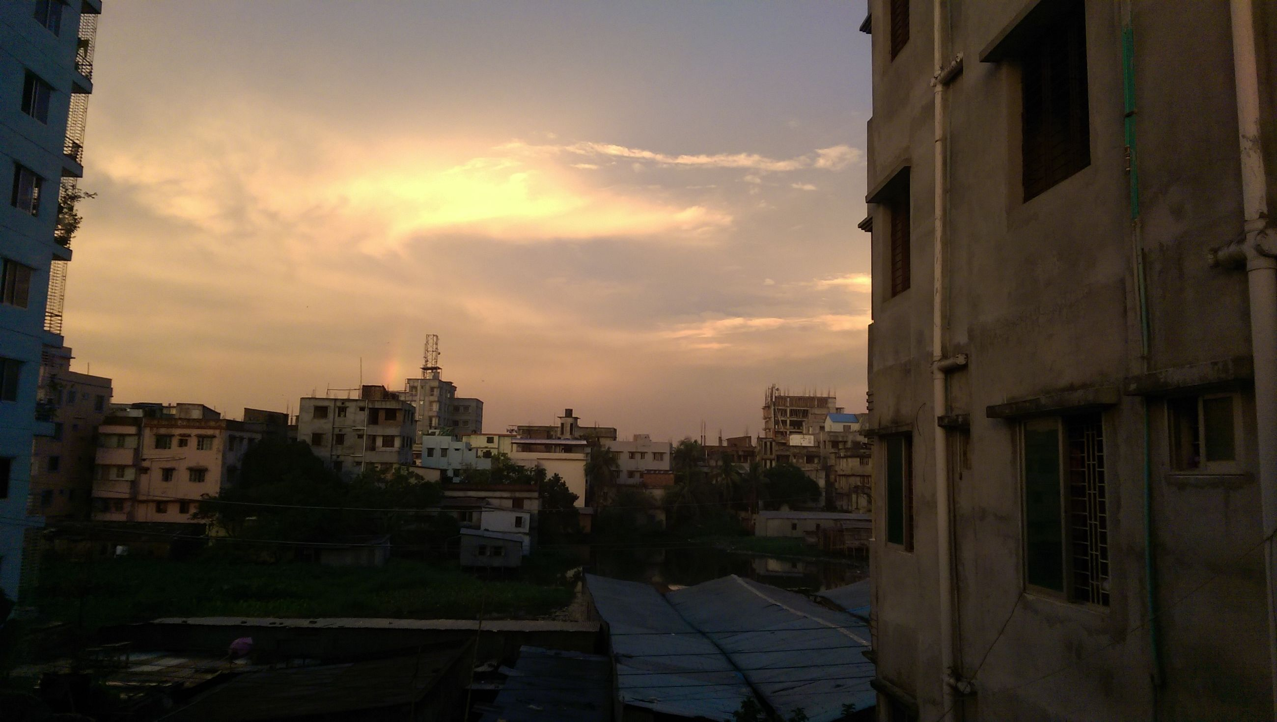 building exterior, architecture, built structure, residential building, residential structure, sky, sunset, city, residential district, cloud - sky, building, house, cloud, cityscape, town, sunlight, outdoors, city life, street, no people