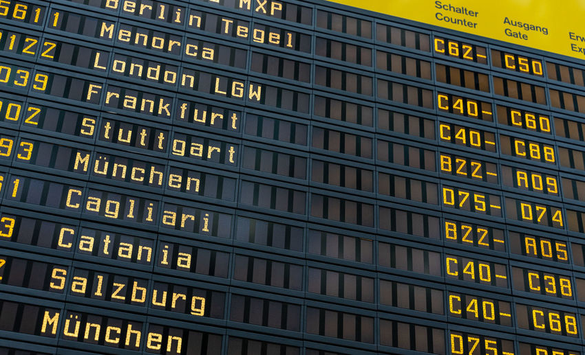 Technology Guidance Repetition Information Sign Yellow Information Illuminated Architecture Full Frame In A Row Backgrounds Sign Western Script Arrival Departure Board No People Text Number Communication Board Timetable Business Finance And Industry Business Traveling Travel Airport Public Transportation