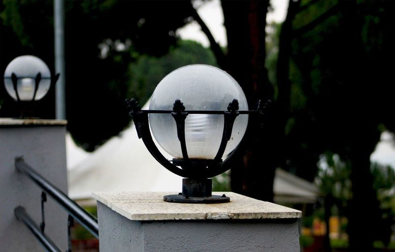 Close-up of electric lamp on street