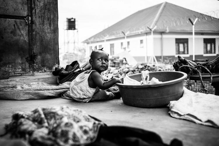 Bnw Photography Reportage Documentary In The Shade African Childhood African Life African Child Village Life Blackandwhite Monochrome Bnw_captures Adjumani Uganda  Innocence Childhood Sitting Social Issues Poverty Poor And Rich Selective Focus