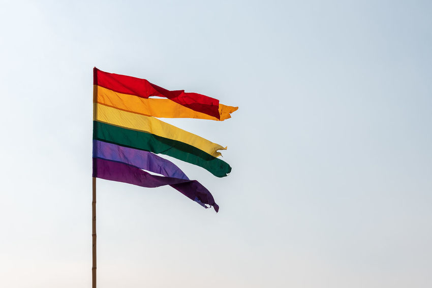 Rainbow flag against blue sky Clear Sky Copy Space Day Environment Flag Lgbt Lgbt Pride Low Angle View Multi Colored Nature No People Outdoors Pole Pride Rainbow Sky Striped Waving Wind