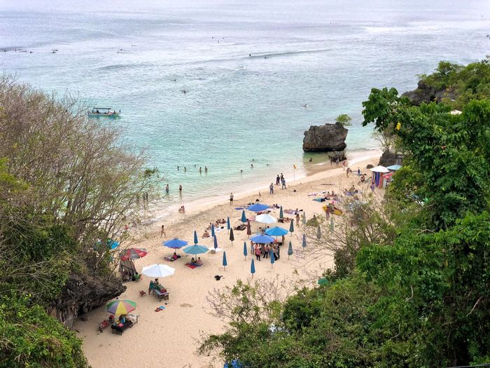 Bali Surf Travel Beach Day Group Of People High Angle View Holiday Horizon Over Water Incidental People Land Leisure Activity Nature Outdoors People Plant Real People Sand Scenics - Nature Sea Tourism Tree Trip Vacations Water