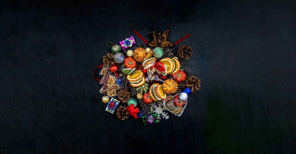 High angle view of decoration on table against black background
