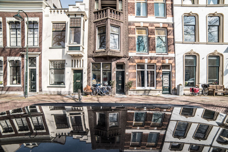 Car roof reflections @ Gouda Building Exterior Built Structure Architecture Building Reflection Window City Day Residential District Water Incidental People Mode Of Transportation Transportation Outdoors Land Vehicle Waterfront Street Nature Canal Apartment