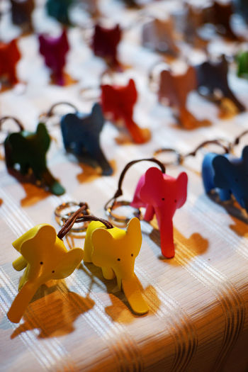 color of elephant Elephant Toy Table Wood - Material Yellow Toy Animal Mammal Puzzle  Doll Dolls Cute Pets Red Key Chain Still Life Close-up Indoors  Animsls Animal Themes Animal No People Focus On Foreground Jigsaw Puzzle
