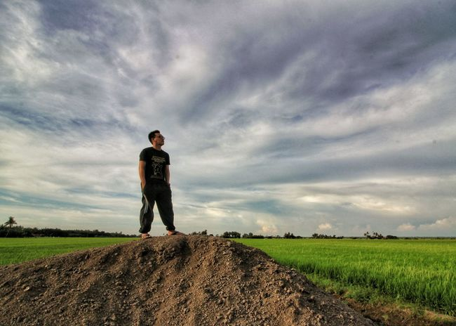 Be. Ready. Only Men One Man Only Field Agriculture One Person Adult Adults Only Full Length Cloud - Sky Standing People Men Sky Grass Outdoors Working Technology Farmer Day Nature