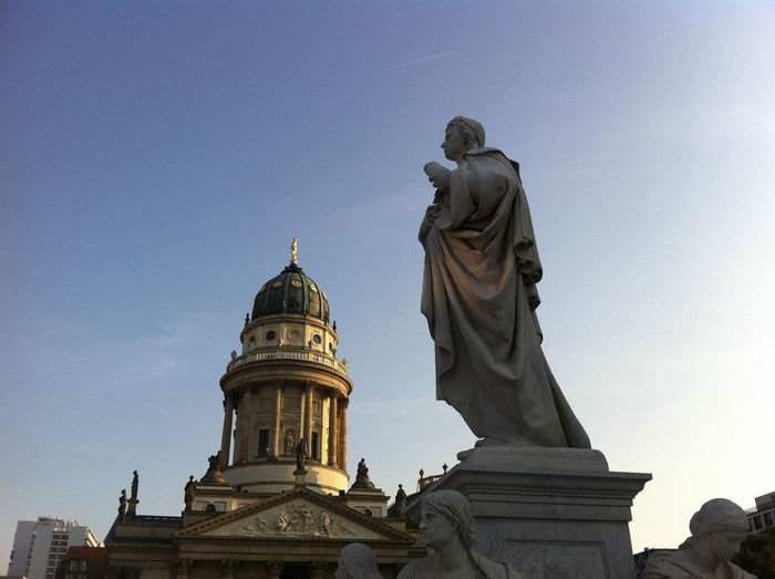 Gendarmenmarkt with Schiller statue and Deutscher Dom (German Cathedral) 'Deutscher Dom' Architecture Art Building Exterior Built Structure Dome Famous Place History Human Representation Low Angle View Place Of Worship Religion Schiller Sculpture Spirituality Statue