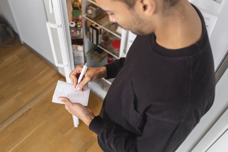 High angle view of man standing at home