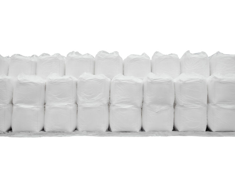 Stacking of sugar in jumbo bags isolated on white Isolated Logistics Raw Rice Stack Sugar Arrangement Backgrounds Bag Bulk Cargo Container Close-up Day Flour In A Row Indoors  Jumbo Bag No People Starch Storage Studio Shot Tapioca White White Background White Color