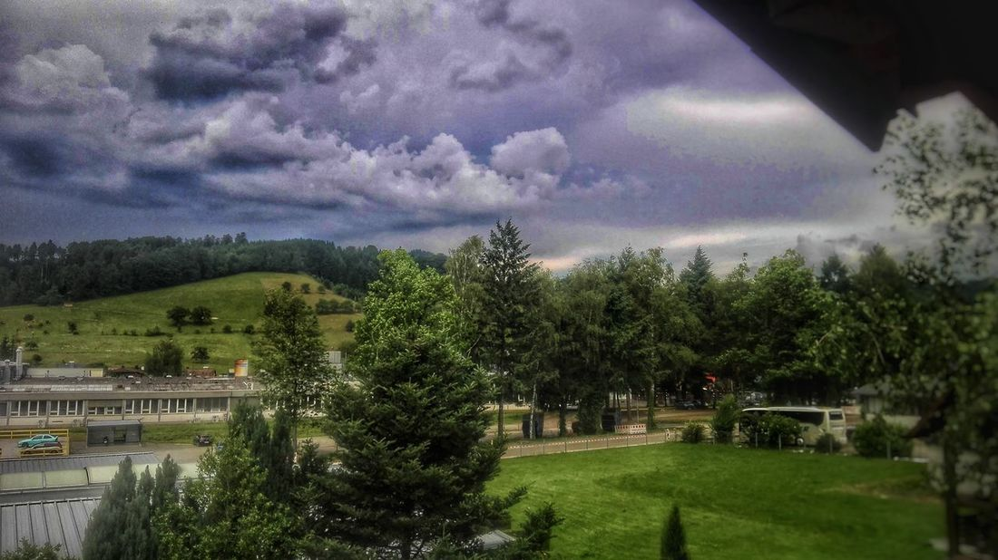 Tree Cloud - Sky Sky No People Storm Cloud Outdoors Nature Growth Day Grass Beauty In Nature Scenic Landscapes Grass Tranquility Freshness Beauty In Nature Illuminated HDR Blue Color Sky And Clouds Rural Scene Green Color Landscape Travelling Built Structure