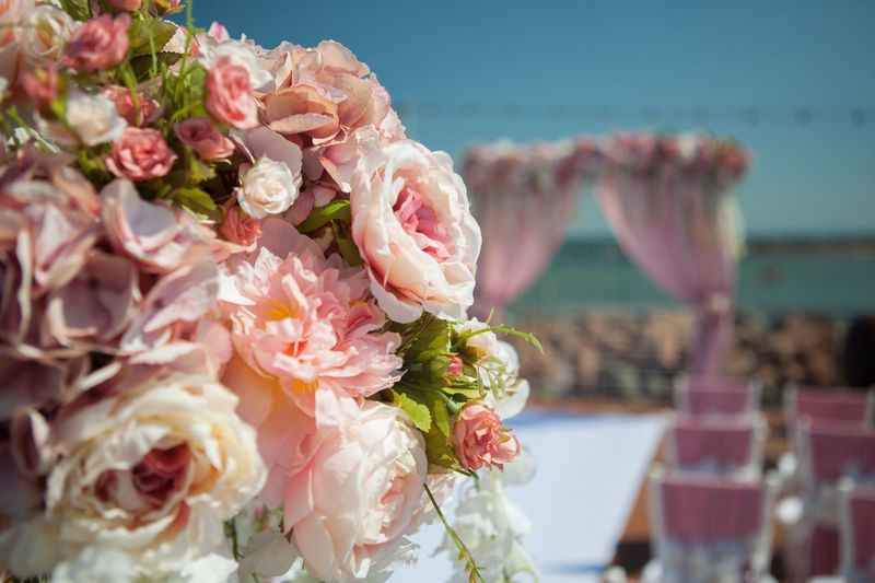 Flower Pink Color Wedding Rose - Flower Freshness Focus On Foreground Bouquet Outdoors No People Beauty In Nature Close-up Celebration Life Events Nature Day Sea Fragility Flower Head Decoration Sea And Sky (null)Ocean Outdoor Wedding Decor
