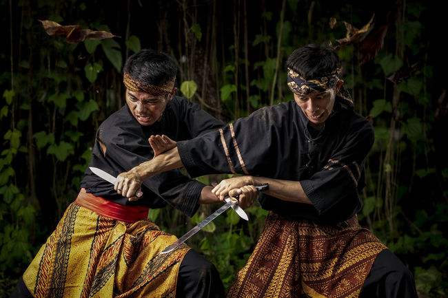 Pencak Silat tradition of Indonesia Fight Fights INDONESIA Indonesian Kick Martial Arts Sparring Traditional Culture Traditional Culture Of Indonesia Culture And Tradition Cultures Indonesia Photography  Indonesia Photography  Indonesian Photographers Collection Kungfu  Men Outdoors Pencak Silat Sports Traditional