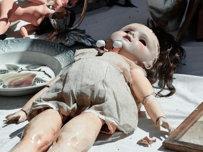Close-up of weathered doll