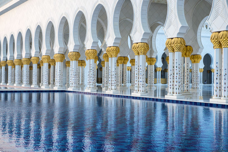 Abu Dhabi Architecture Building Building Exterior Grand Mosque Grand Mosque Abu Dhabi Mosque Pillar Pillars Travel Travel Destinations Traveling UAE Water Water Reflections