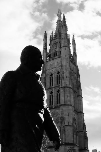 Facing the sun Religion Spirituality Place Of Worship Low Angle View Building Exterior Sky Architecture Built Structure Real People History Outdoors Travel Destinations Day Men One Person Photooftheday EyeEmBestPics EyeEm Best Shots Eye4photography  Blackandwhite