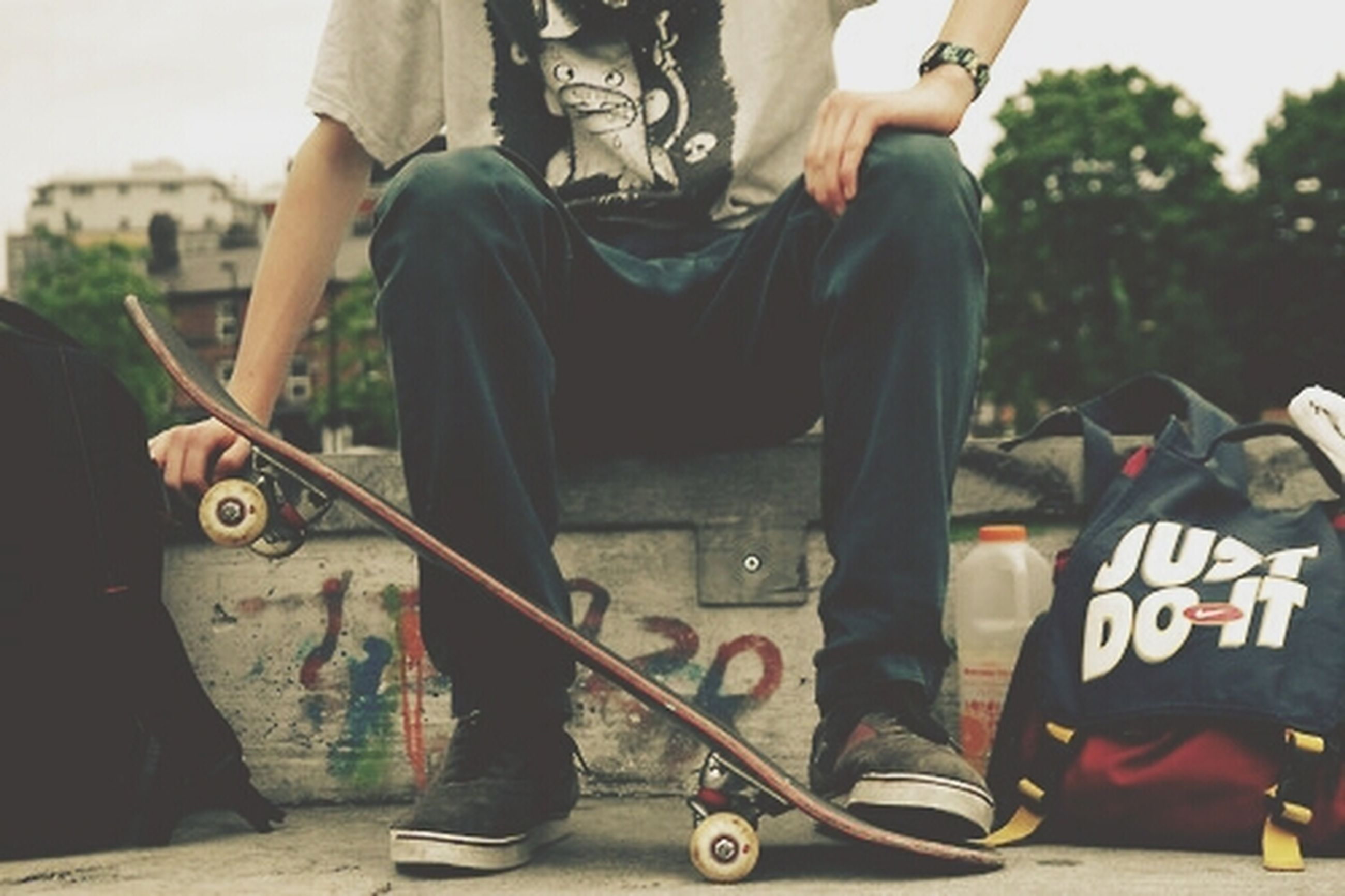 low section, lifestyles, men, person, leisure activity, shoe, transportation, casual clothing, mode of transport, land vehicle, midsection, standing, part of, skill, skateboard
