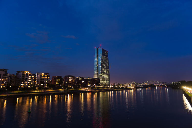 Architecture Blue Building Exterior Building Story Built Structure Calm City Development European Central Bank EZB Frankfurt Financial District  Frankfurt Am Main Multi Colored Night Office Building Outdoors Reflection River Sky Skyscraper Tall - High Tower Urban Skyline Water Waterfront