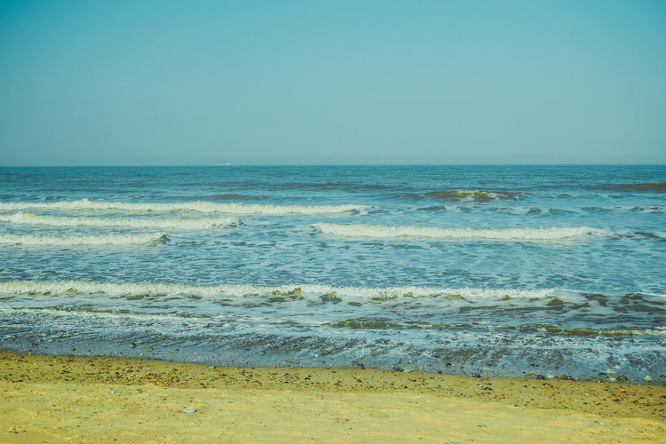 Sea Water Horizon Over Water Horizon Beach Sky Land Scenics - Nature Beauty In Nature Wave Motion Clear Sky Tranquil Scene Tranquility Outdoors Sea Scape Beach Photography No People Sand Space For Text Space For Copy