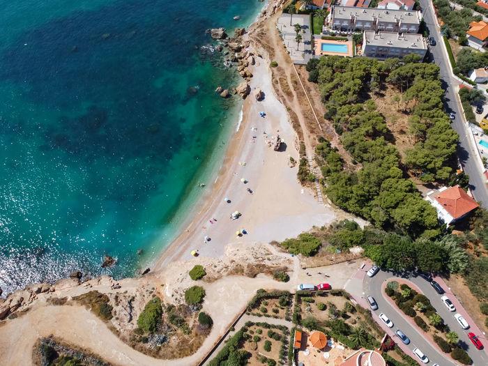 Aerial view of a small beach in the mediterranean sea. north of vinaros city, cala del pinar.