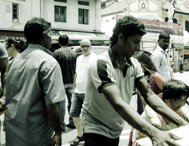 Rear view of men walking in city