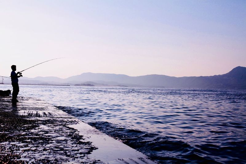 Coast fishing Fishing Water Sea Sky Scenics - Nature Real People One Person Clear Sky Fisherman Sunset First Eyeem Photo