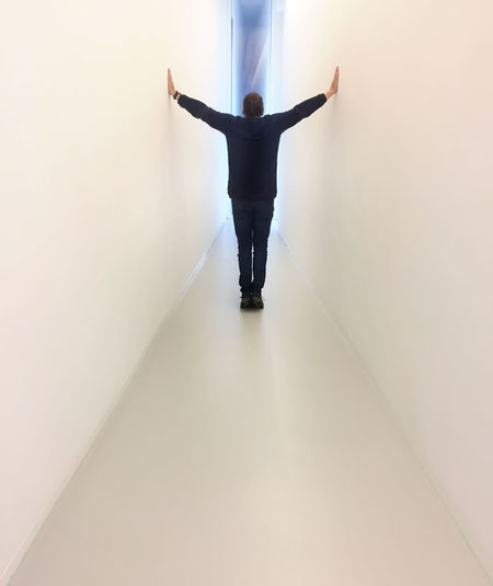Rear view of man with arms outstretched