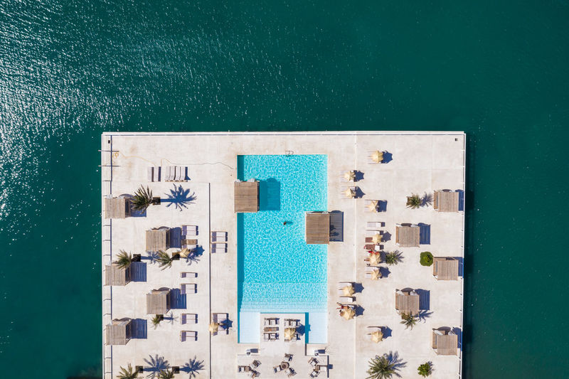 High angle view of swimming pool against building in city