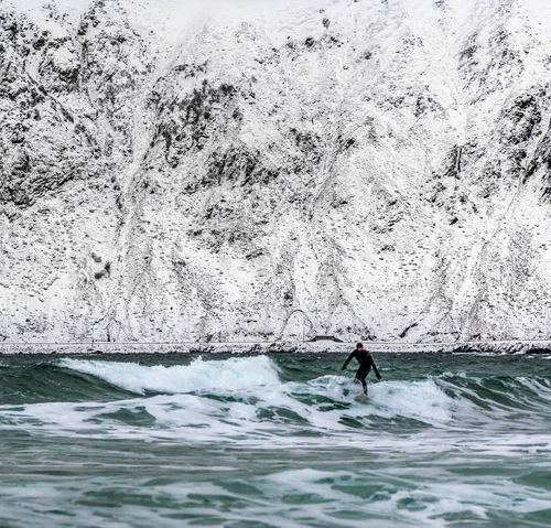 Norway Surfer Winter Adventure Arctic Beauty In Nature Day Extreme Sports Leisure Activity Lifestyles Lofoten Men Nature Nautical Vessel One Person Outdoors People Real People Sea Sport Water Waterfront