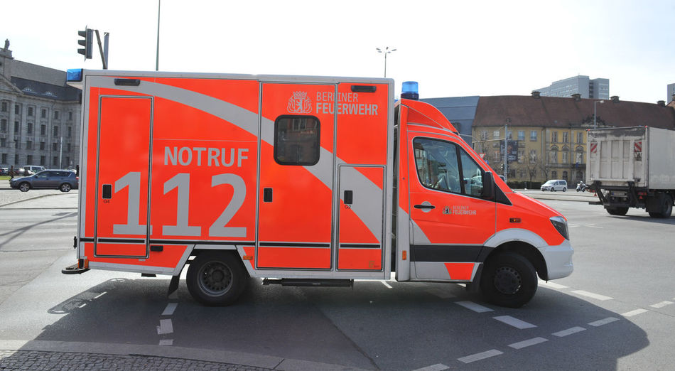 ambulance Berlin Mitte Berlin Photography Ambulance Ambulance Service Architecture Building Exterior Built Structure Call 112 City Communication Day Land Vehicle Mode Of Transportation Motor Vehicle Nature No People Outdoors Red Rescue Road Sign Street Text Transportation Truck