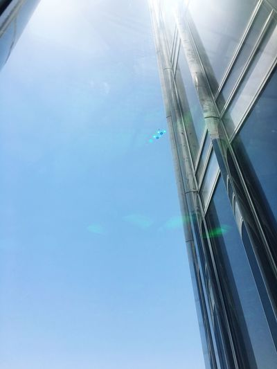 Shine through. Chadventurestories Architecture Built Structure Low Angle View Day Blue Reflection Window No People Sky Modern Skyscraper Building Exterior Outdoors City Water Nature EyeEm EyeEm Best Shots EyeEmNewHere EyeEm Selects EyeEm Gallery Summer Photography