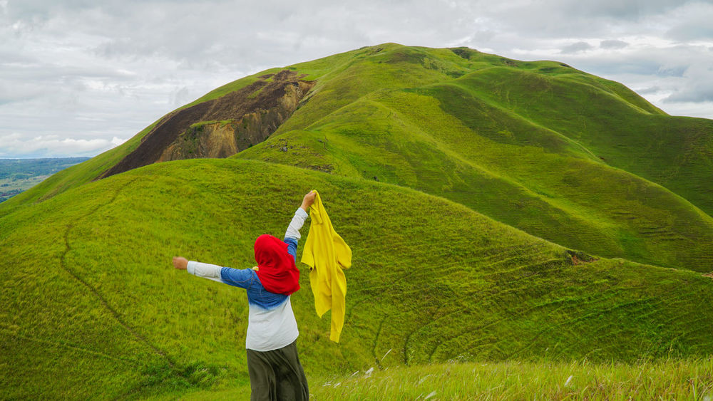 View at on top of a hill at Samosir Island, Indonesia, near the majestic famous Lake Toba or Danau Toba Day Grass Grass And Hill Grassy Grassy Field Grassy Hillside Grassy Mountain Grassy Mountains Green Green Landscape Greenery Happy Happy People Lake Toba Lake Toba From Above Lake Toba From Top Long Grasses Medan Indonesia Muslim Travel Nature Outdoors Samosir Island  Samosir Island Indonesia Samosir Island Medan Windy Day