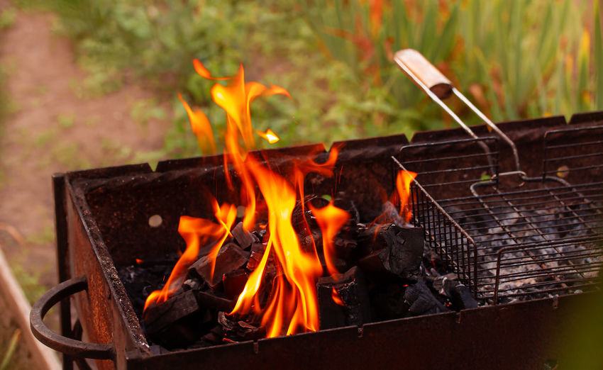 Close-up of fire on barbecue grill