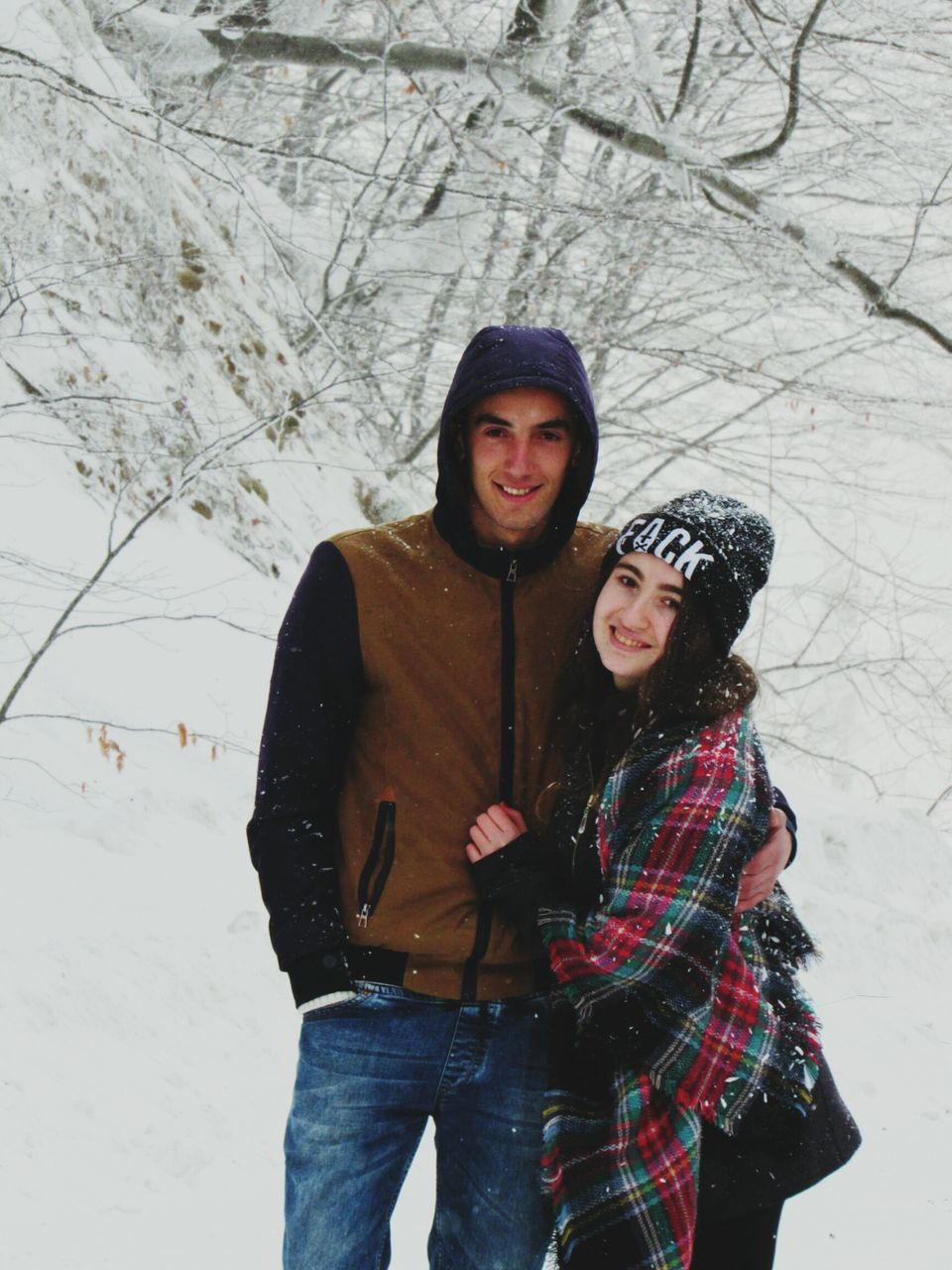 winter, cold temperature, snow, smiling, looking at camera, togetherness, happiness, leisure activity, real people, two people, portrait, lifestyles, young women, standing, warm clothing, love, knit hat, outdoors, day, bonding, young adult, friendship, cheerful, nature