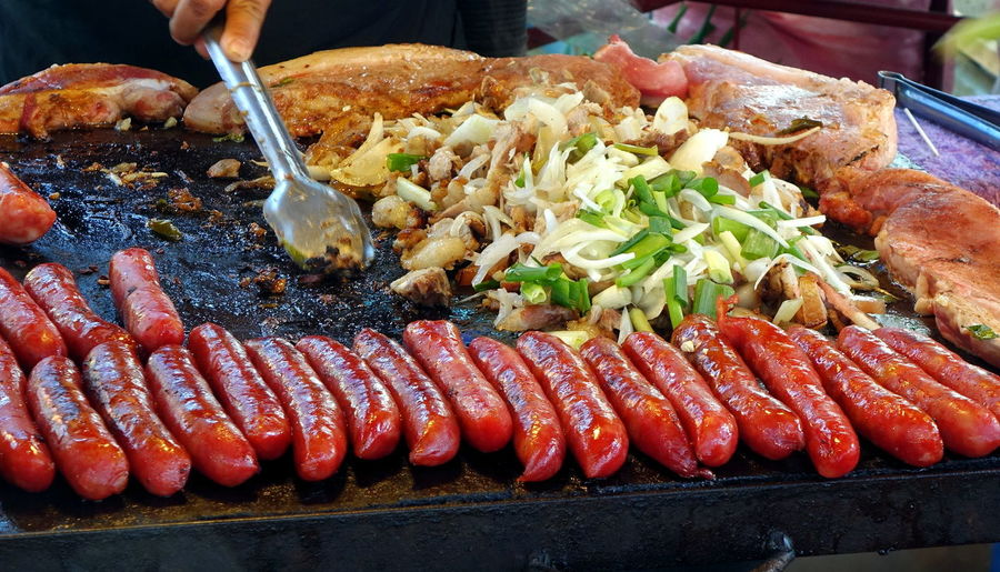 Taiwan indigenous food, sausages, fried pork and onions Fried Pork Indigenous Food Taiwan Food Barbecue Food Food And Drink Freshness Fried Onions Grilled Sausage Leeks Meat Pork Chops