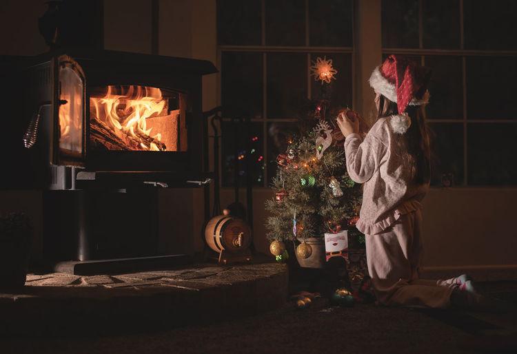 Burning Fire Christmas Fireplace Indoors  Flame Decoration Celebration christmas tree Holiday Christmas Decoration Home Interior Night Heat - Temperature Holiday - Event Illuminated 8 Years Old Childhood Females Kids