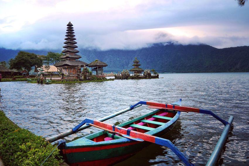Canoe on the Lake EyeEmNewHere Mountains Temple Canoe Trip Canoe Lake Ulun Danu Temple Bali, Indonesia Water Cloud - Sky Sky Nature No People Religion Architecture Built Structure Lake Scenics - Nature EyeEmNewHere