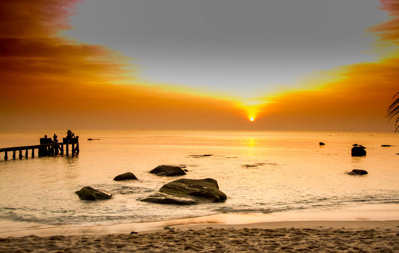 Sunset at Phú Quốc, Vietnam. ASIA Beach Beauty In Nature Day Horizon Over Water Idyllic Nature Ocean Ocean View Orange Color Outdoors Rock - Object Sand Sea Silhouette Sky Sun Sunset Sunset Silhouettes Travel Destinations Travelling Vacations Vietnam Water Wave