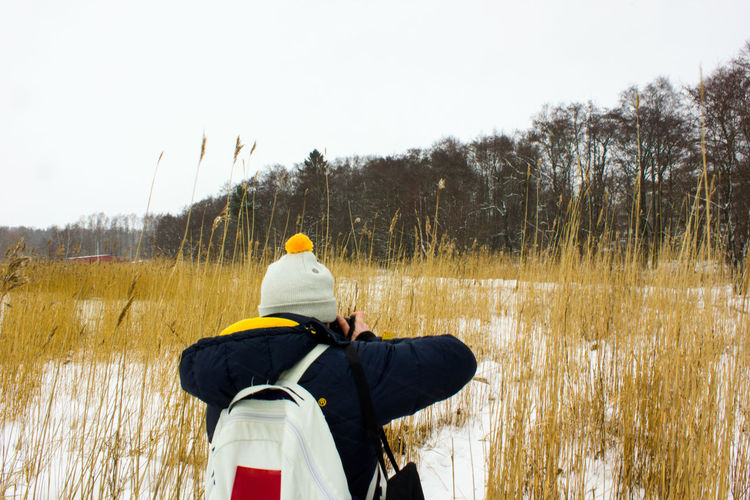 Adventure Beauty In Nature Cold Temperature Day Leisure Activity Lifestyles Men Nature One Person Outdoors People Real People Rear View Sky Standing Tree Warm Clothing Winter Modern Workplace Culture