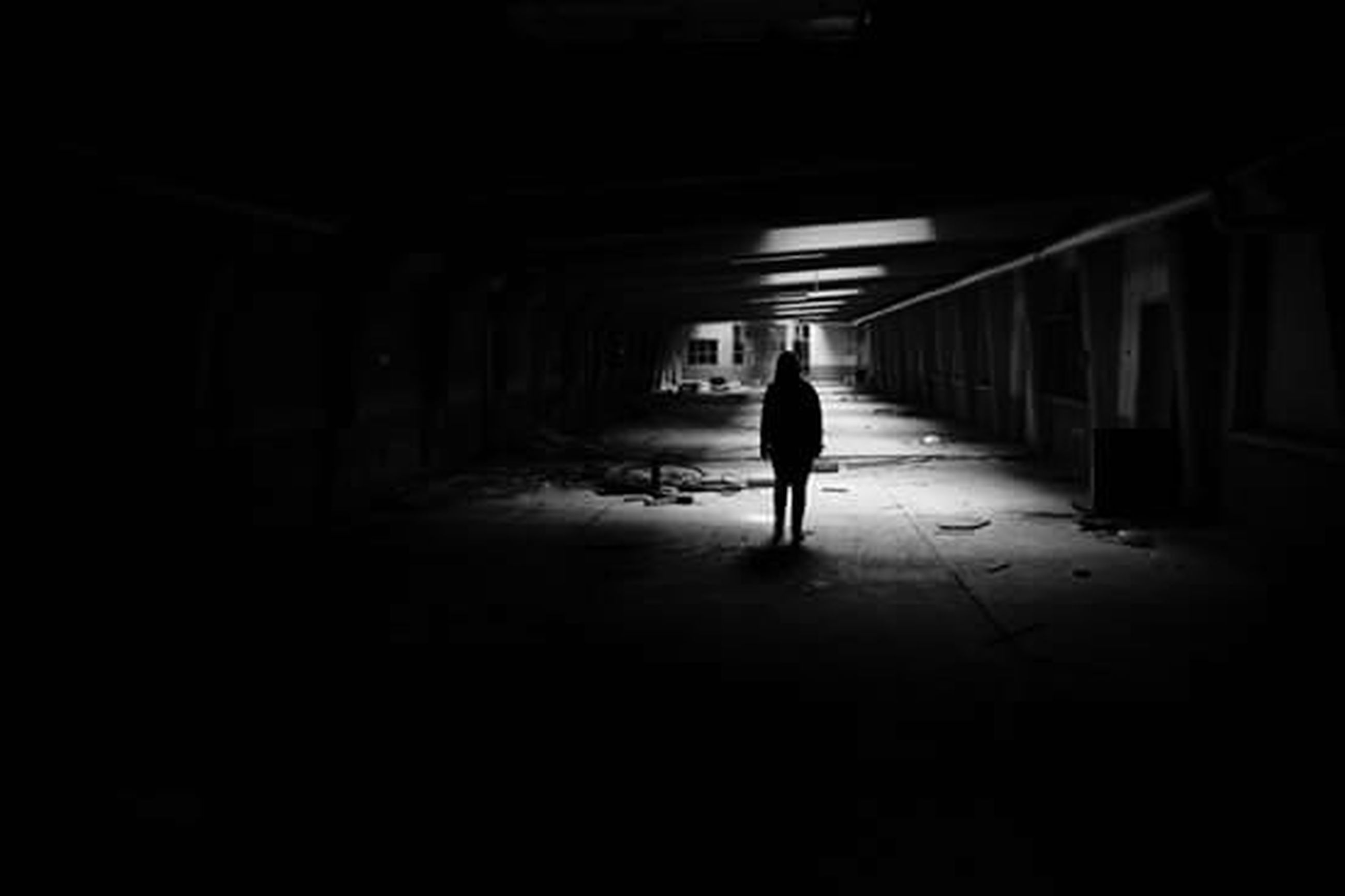 walking, full length, indoors, rear view, lifestyles, architecture, men, silhouette, tunnel, built structure, the way forward, illuminated, person, leisure activity, corridor, unrecognizable person, standing, on the move