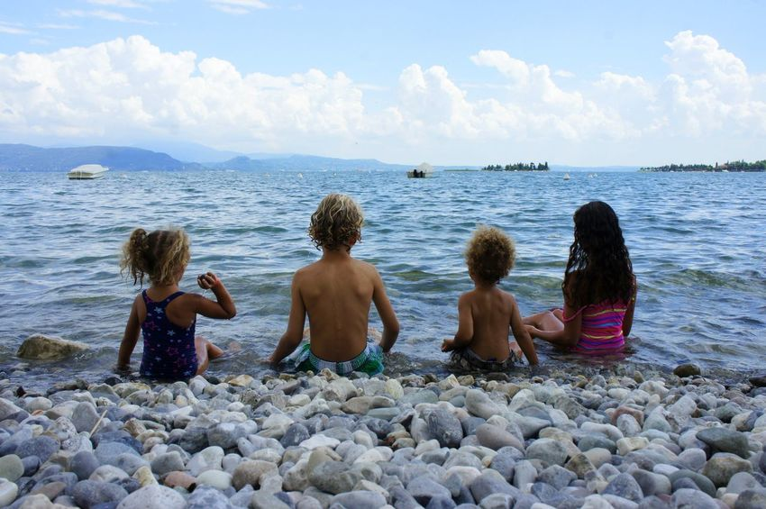 Children Siblings Brother & Sister Day Childhood Water Lakeshore Lake Lake Garda Italy Pebbles On A Beach Pebbles